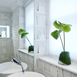 Photo of a contemporary cloakroom in London with a vessel sink.