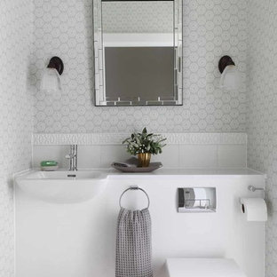 Photo of a traditional cloakroom in Other with a wall mounted toilet, multi-coloured walls and a wall-mounted sink.
