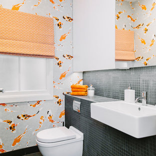 Example of a mid-sized ornate mosaic tile slate floor and gray floor powder room design in London with a wall-mount toilet, white walls, a drop-in sink and gray countertops