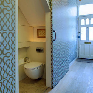 Design ideas for a small contemporary cloakroom in London.