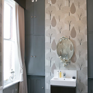 Design ideas for a large traditional cloakroom in Dorset with grey cabinets, grey tiles, a two-piece toilet, grey walls, grey floors and an integrated sink.