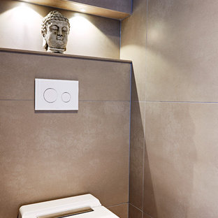 Inspiration For A Small Modern Cloakroom In Devon With Wall Mounted Toilet Beige Tiles