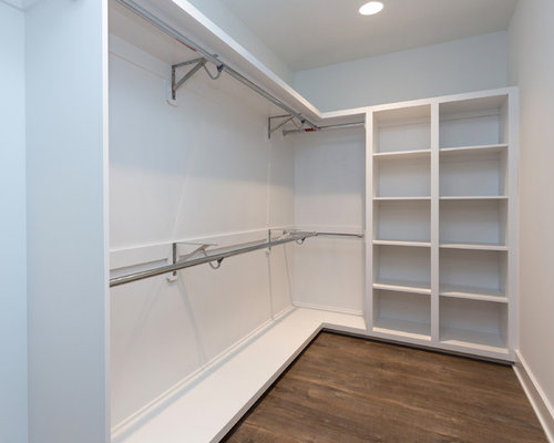 example of a mid sized minimalist gender neutral walk in closet design in - Wall Closet Design