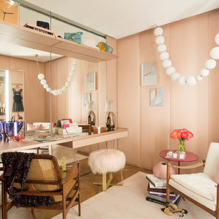 Inspiration for an eclectic women's medium tone wood floor dressing room remodel in New York