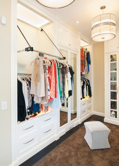 Traditional Closet by Precision Cabinets