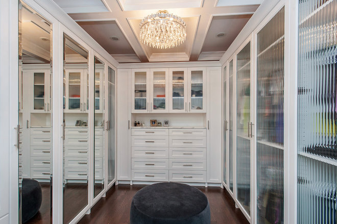 Contemporary Closet by Heritage Luxury Builders