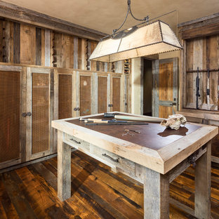 Design ideas for an expansive country storage and wardrobe in Salt Lake City with shaker cabinets, distressed cabinets, medium hardwood floors and brown floor.