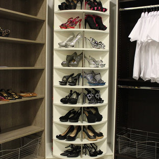 Example of a mid-sized trendy gender-neutral walk-in closet design in Miami