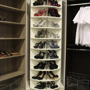 Mid-sized contemporary gender-neutral walk-in wardrobe in Miami.