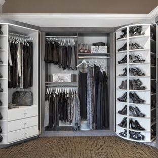 Example of a transitional gender-neutral walk-in closet design in Chicago with open cabinets and gray cabinets