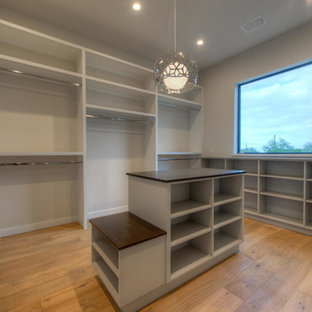 Inspiration for a large modern gender-neutral light wood floor dressing room remodel in Austin with flat-panel cabinets and gray cabinets