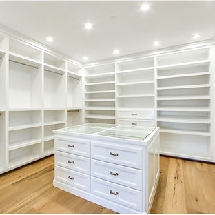 Huge country gender-neutral walk-in closet photo in Los Angeles with flat-panel cabinets and white cabinets