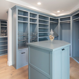 Walk-in closet - transitional women's walk-in closet idea in San Francisco with beaded inset cabinets and blue cabinets