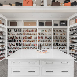 Example Of A Huge Tuscan Gender Neutral Walk In Closet Design In  Indianapolis
