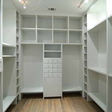 Transitional Closet by Southland Homes of Texas