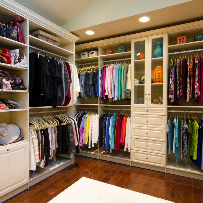 This space truly allowed us to create a luxurious walk in closet with a boutique feel. The room has plenty of volume with the vaulted ceiling and terrific lighting. The vanity area is not only beautif