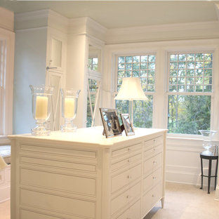 Walk-in closet - traditional walk-in closet idea in DC Metro with white cabinets