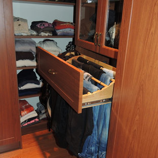 Photo of a mid-sized contemporary women's dressing room in Philadelphia with recessed-panel cabinets and medium wood cabinets.
