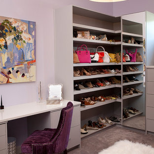 Inspiration for a mid-sized contemporary women's carpeted and gray floor dressing room remodel in Dallas with open cabinets and gray cabinets