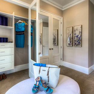 Example of a classic dressing room design in Atlanta with white cabinets