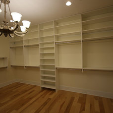 Transitional Closet by First Coast Custom Homes