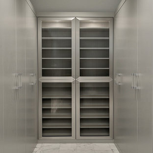 Walk-in closet - contemporary men's marble floor walk-in closet idea in Orlando with flat-panel cabinets and gray cabinets