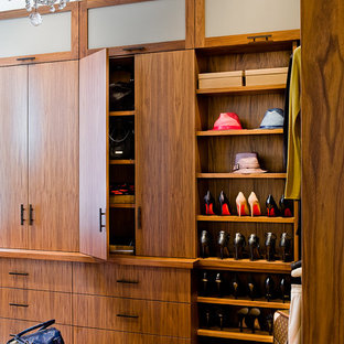 Closet - contemporary medium tone wood floor closet idea in Boston with flat-panel cabinets and dark wood cabinets