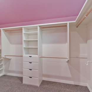Walk-in closet - large shabby-chic style women's carpeted walk-in closet idea in Portland with white cabinets and flat-panel cabinets