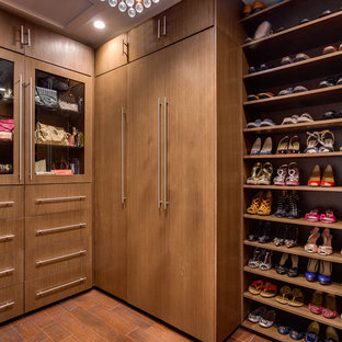 This is an example of a contemporary gender-neutral walk-in wardrobe in Miami with medium wood cabinets, dark hardwood floors, flat-panel cabinets and brown floor.