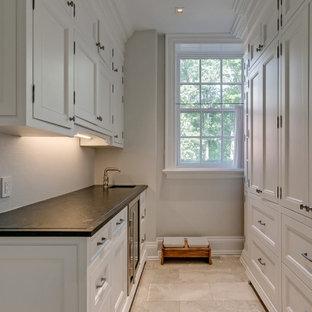 Foto de armario vestidor unisex, grande, con armarios con paneles empotrados, puertas de armario blancas, suelo de mármol y suelo beige