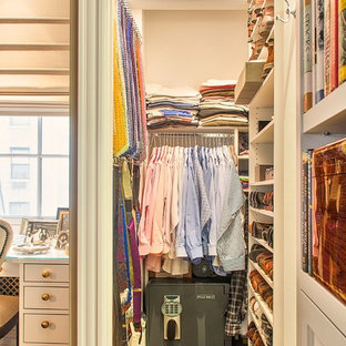 Walk-in closet - small traditional men's medium tone wood floor walk-in closet idea in Orange County with open cabinets and white cabinets