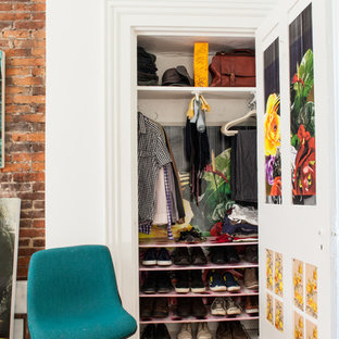 Example of an eclectic reach-in closet design in Other with open cabinets and white cabinets