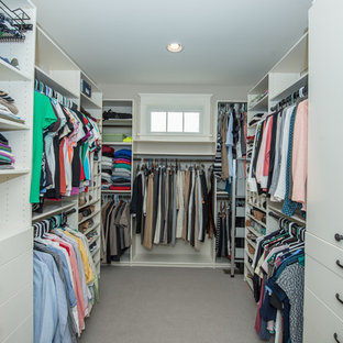 Inspiration for a large timeless gender-neutral carpeted and gray floor walk-in closet remodel in Other with open cabinets and white cabinets