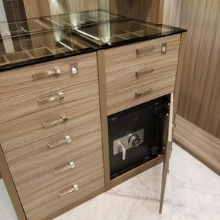 Inspiration for a large transitional gender-neutral walk-in wardrobe in Miami with open cabinets, light wood cabinets, marble floors and white floor.