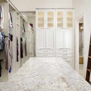 Inspiration for a transitional carpeted and gray floor closet remodel in Houston with glass-front cabinets