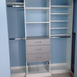 Mid-sized minimalist men's carpeted reach-in closet photo in Orlando with flat-panel cabinets and white cabinets