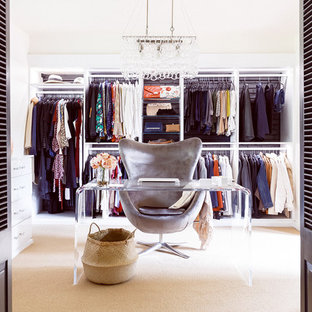 Inspiration for a large midcentury women's dressing room in Houston with open cabinets, white cabinets, carpet and beige floor.