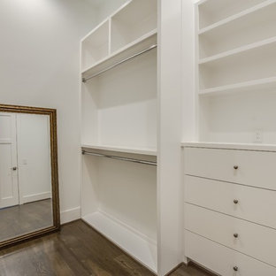 Inspiration for a mid-sized midcentury gender-neutral walk-in wardrobe with shaker cabinets, white cabinets, medium hardwood floors and brown floor.