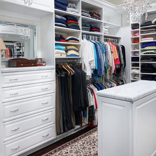 Example of a large trendy gender-neutral dark wood floor walk-in closet design in Philadelphia with white cabinets and raised-panel cabinets