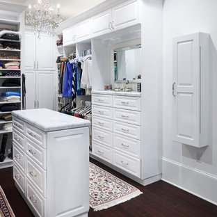 Walk-in closet - large contemporary gender-neutral dark wood floor walk-in closet idea in Philadelphia with recessed-panel cabinets and white cabinets