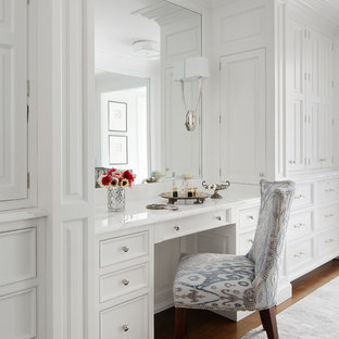 Large elegant women's dark wood floor dressing room photo in Chicago with beaded inset cabinets and white cabinets