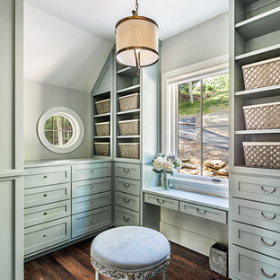 Photo of a large country gender-neutral dressing room in Other with shaker cabinets, green cabinets and dark hardwood floors.