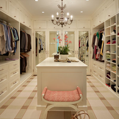Example of a classic carpeted closet design in Seattle with beige cabinets