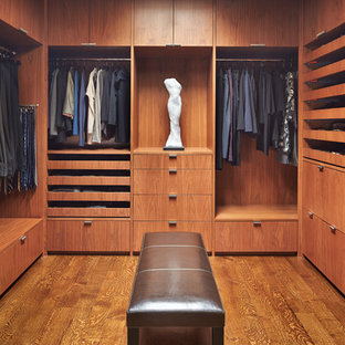 Large trendy men's medium tone wood floor dressing room photo in Seattle with flat-panel cabinets and medium tone wood cabinets