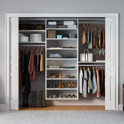 Inspiration for a small contemporary gender-neutral reach-in closet remodel in Hawaii with white cabinets