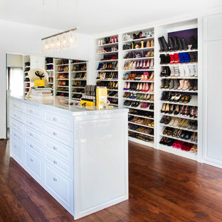 Large transitional women's dark wood floor dressing room photo in Los Angeles with raised-panel cabinets and white cabinets