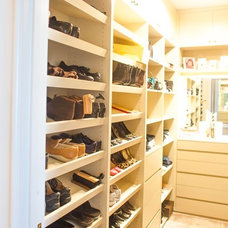 Contemporary Closet by RenovationMetro