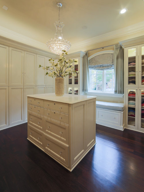 Large Elegant Womenu0027s Dark Wood Floor Dressing Room Photo In Charlotte With  Recessed Panel Cabinets