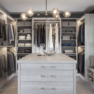 Example of a large transitional closet design in New York
