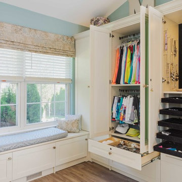 Chic Walk-In Closet And Sitting Room With Storage Options